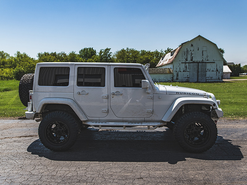 2015 Jeep Wrangler Rubicon With 4 Inch Lift Kit Xd Series Rockstar Iii  20x12 44 Offset