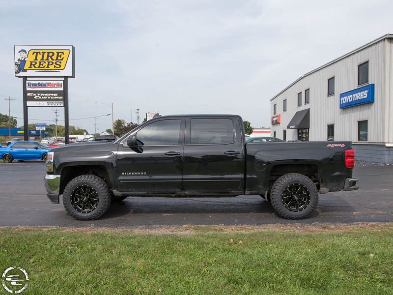 2017 Chevy Silverado 1500 With 2 Inch Rough Country Leveling Kit Moto Metal 962 Mo962b 18x9 0 Offset 18 By 9 Inch Wide Wheel Atturo Trail Blade Mt 275 65r18 Tire