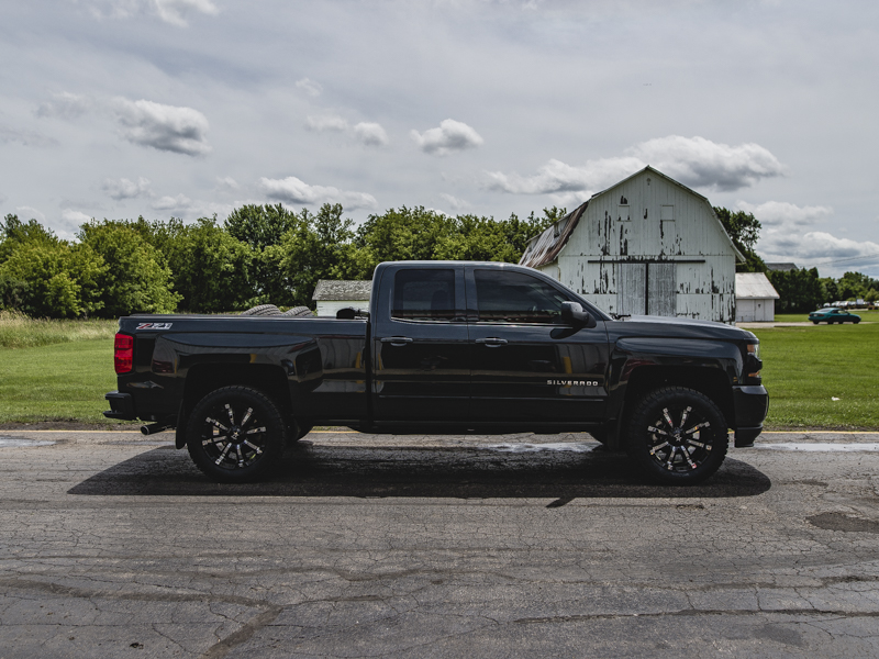 2017 Chevy Silverado 1500 With 2 Inch Rough Country Leveling Kit Rolling Big Power 94r 20x9 +0 Offset 20 By 9 Inch Wide Wheel Nitto Terra Grappler G2 285 55r20 Tire